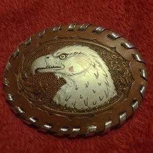 An American Eagle belt buckle